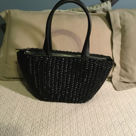 Black wicker Sandra Roberts purse Beautiful new black wicker bag. Gorgeous floral lining and a top zipper. Classy and chic go anywhere bag! Sondra roberts Bags Satchels