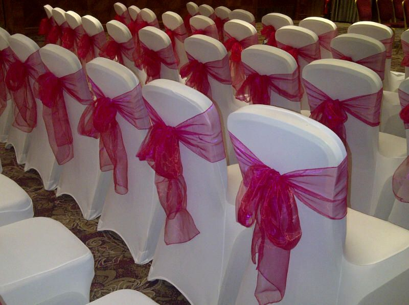 chair covers hire in wolverhampton oversized reading chairs white lycra with fuchsia pink organza sashes by midlands cover