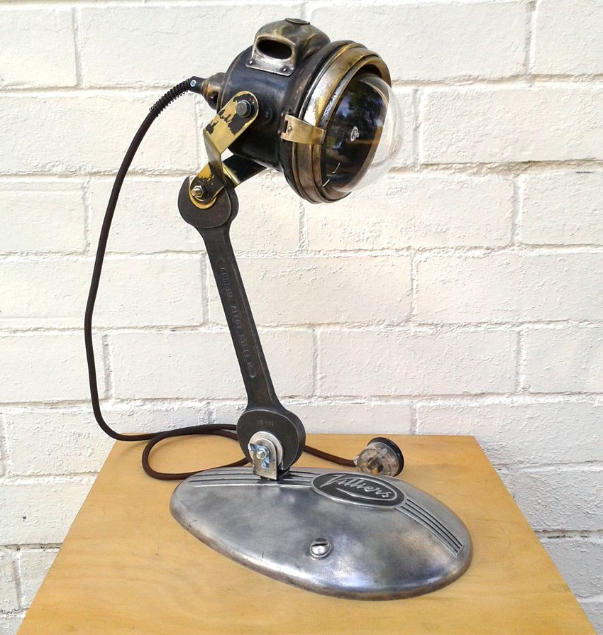 Table lamp featuring a vintage carbide headlight casing and a table lamp featuring a vintage carbide headlight casing and a villiers engine side cover aloadofball Choice Image