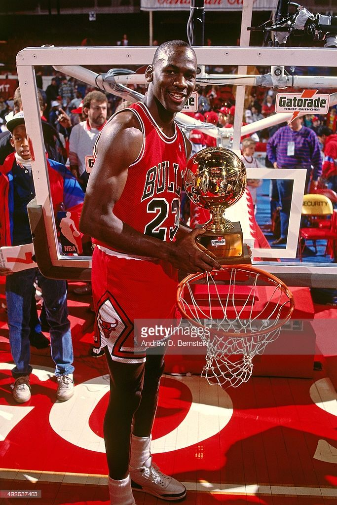 86706993b12 Michael Jordan #23 of the Chicago Bulls poses with the trophy after winning  the 1988 Slam Dunk Contest as part of All-Star Weekend on February 6, ...