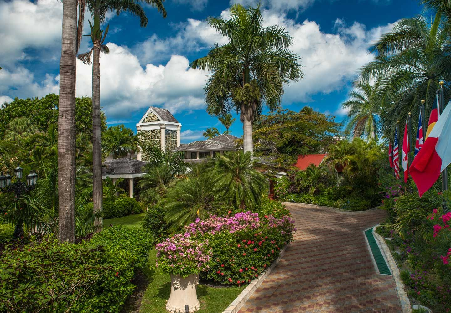 c1580c1422599 Enter authentic tranquility of the tropical Caribbean Village main entrance.
