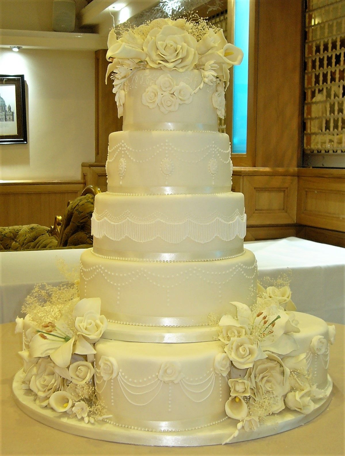 Four 8 inch base cakes and a 12/10/8/6 inch cake makes up this eight ...
