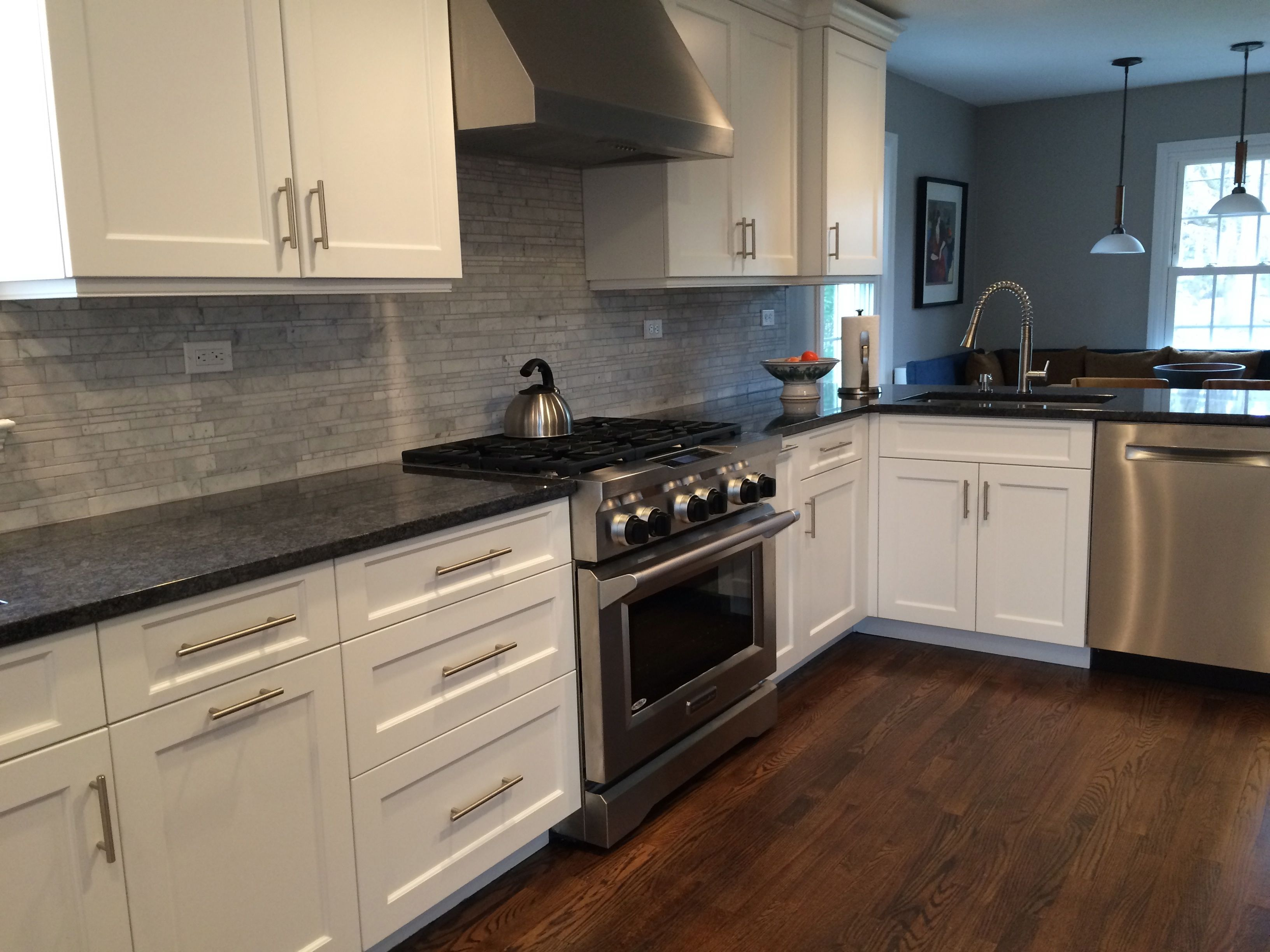 Counters Are Polished Steel Gray Granite Backsplash Is Carrara