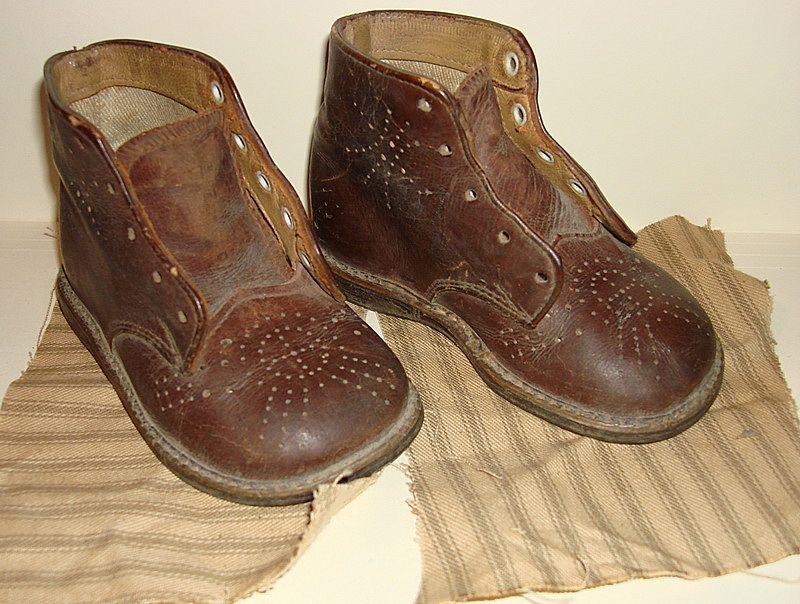 vintage pair of brown baby shoes