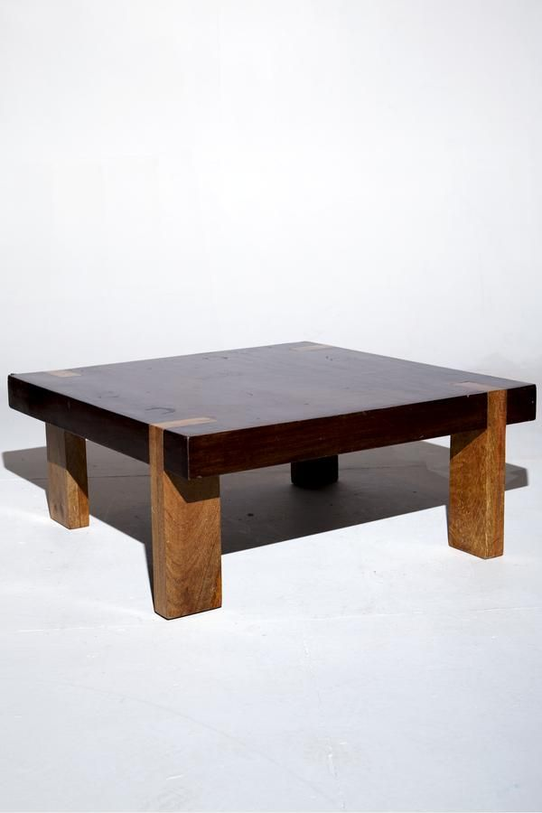 mixed wood leg coffee table