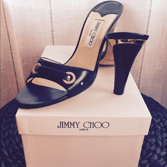 "Jimmy Choo black and gold mules Authentic with original box and felt bag. Black mules with gold details. Black snakeskin exterior heel with gold interior. Gently worn. 3.5"" heel. Jimmy Choo Shoes Heels"
