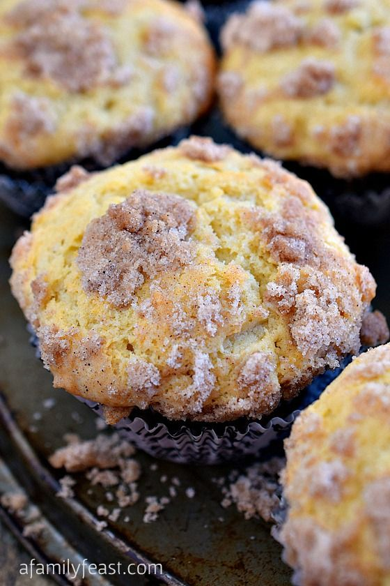 Sour Cream Coffee Cake Muffins - The perfect breakfast muffin! Super moist and delicious thanks to sour cream in the batter and a sweet streusel is baked inside the muffin as well as sprinkled on top!