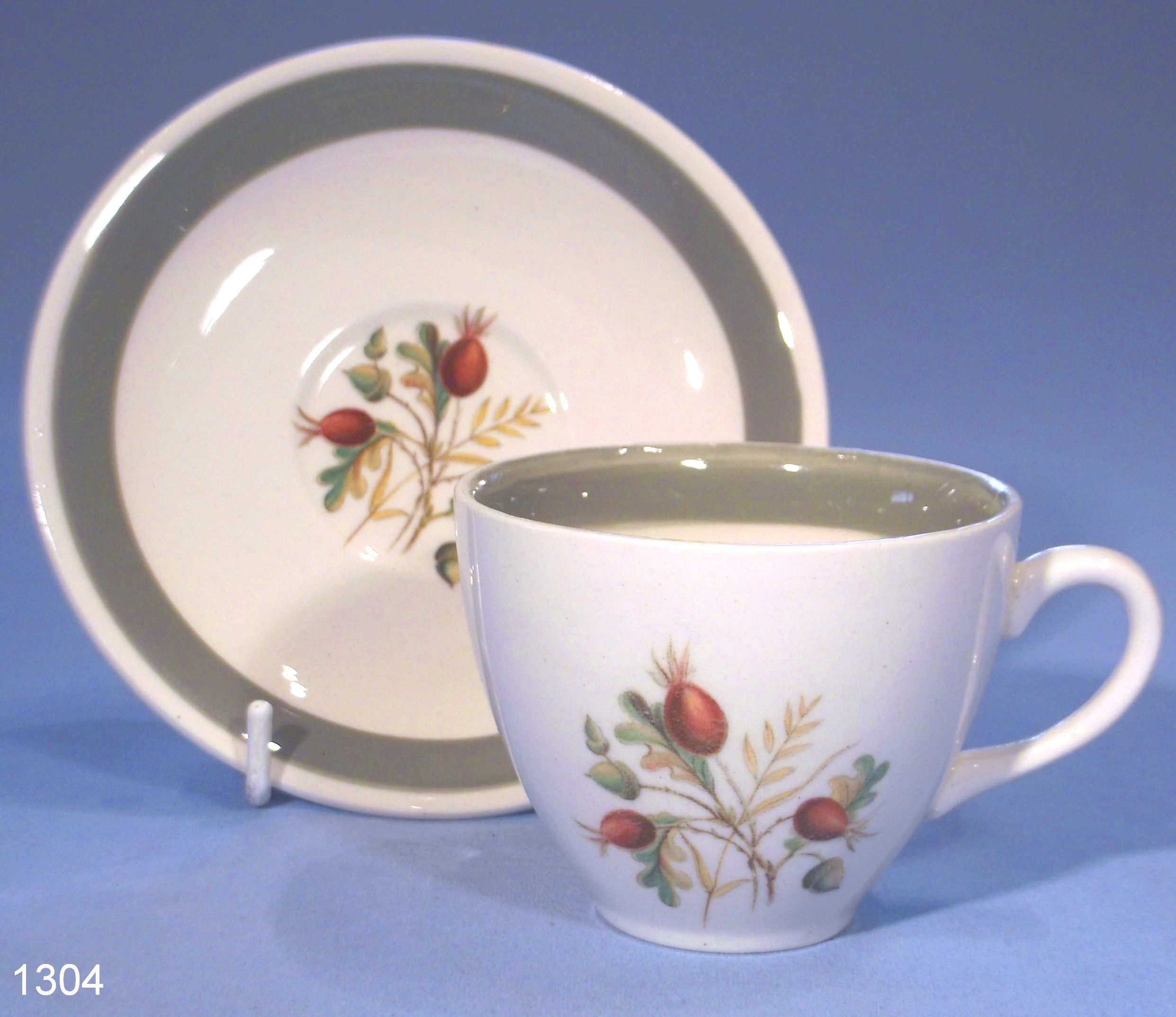 Alfred Meakin Rose Hip Coffee Cup and Saucer  Coffee Cup & Saucer made by  Alfred Meakin in the 1950s-1960s. Rosehip design with sage green border.