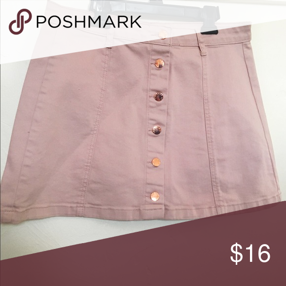 Forever 21 denim skirt Made in light pink denim with rose gold buttons lining the front. Perfect for the upcoming spring weather. Forever 21 Skirts Mini