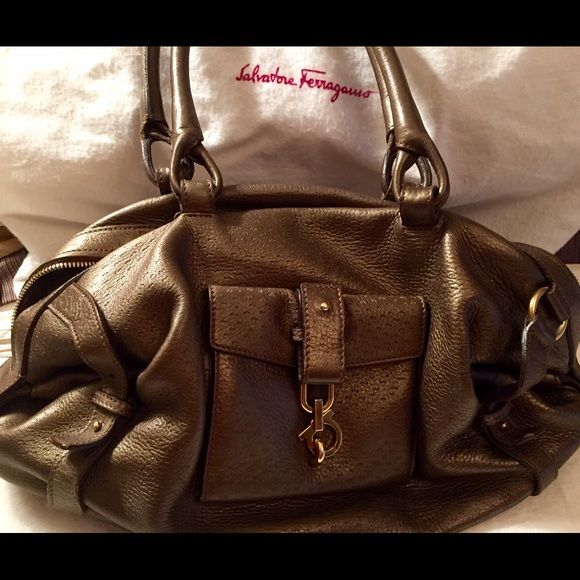 Salvatore Ferragamo gold leather bag Bag is in good condition, shoes some minor wear, authentic, nice every day bag. Please use offer feature, no PP or trades. Thank you! Ferragamo Bags Shoulder Bags