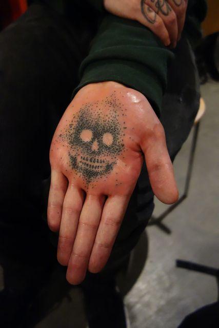 Negative Skull on Palm by Nathan Kostechko