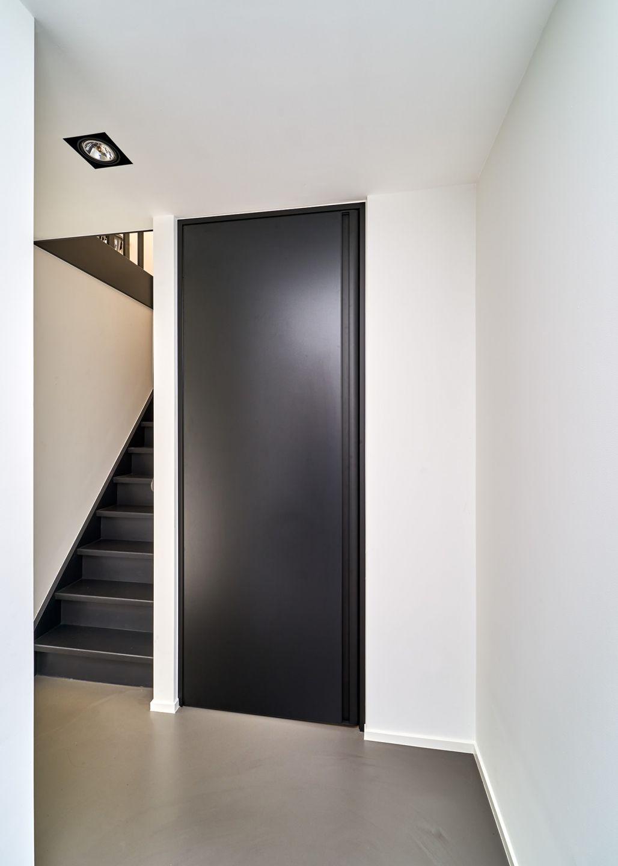 Black interior door from floor to ceiling with a bko door frame and