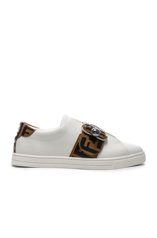 Fendi Logo Print Buckle Strap Sneakers in White, Black   Brown   FWRD dc211ee4ae35