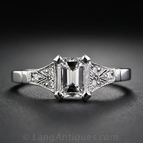 An ice-white, high-quality emerald-cut diamond, weighing .90 carat and accompanied by an EGL diamond grading certificate stating D color