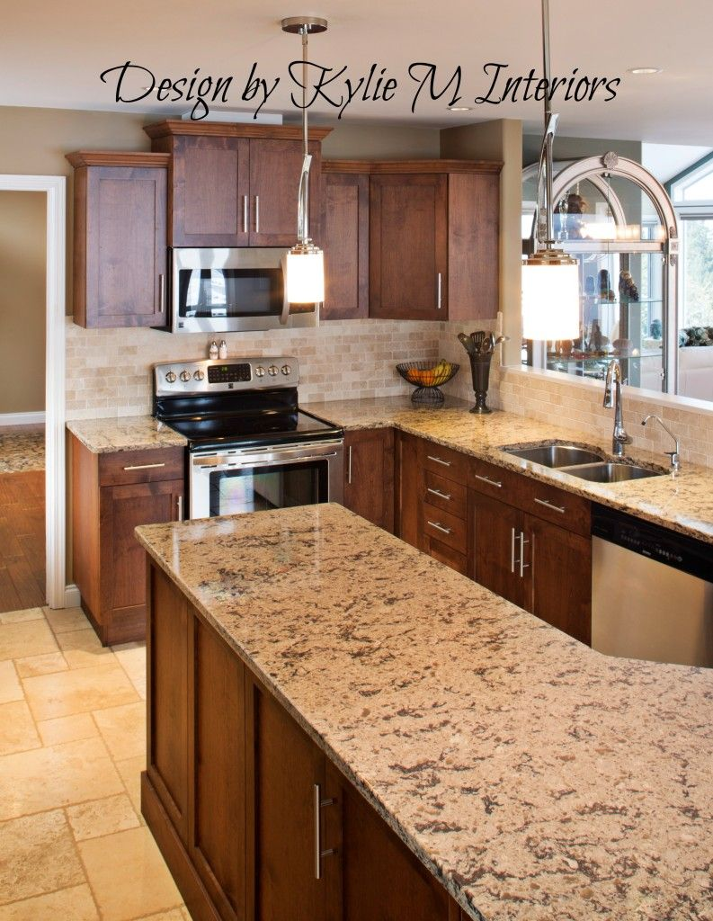 dark maple cabinets granite counter and travertine tile floor and