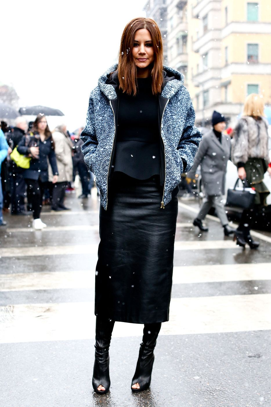 very cool mix...print hoodie, leather skirt and open toe booties ...