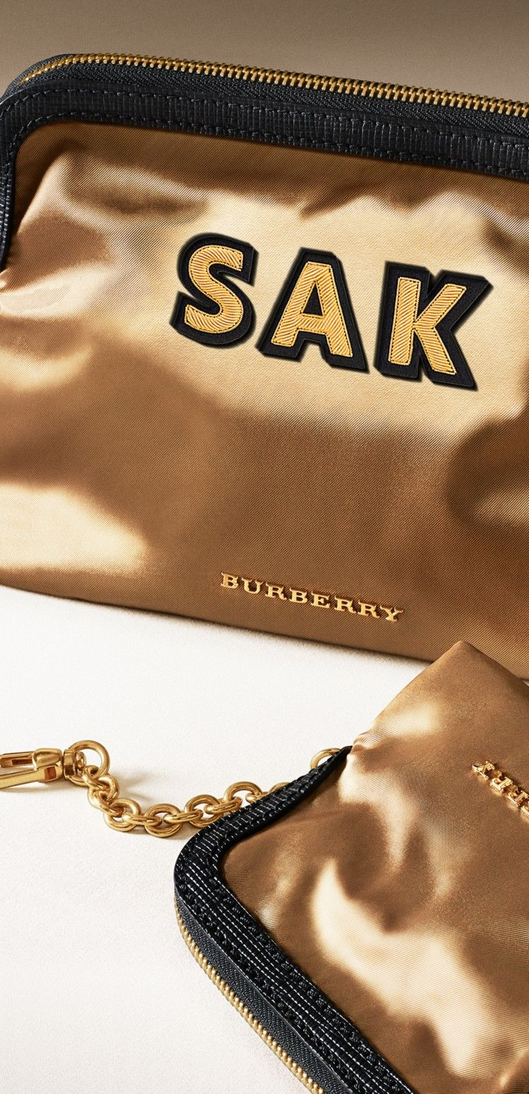 The Burberry zip-top pouch doubles as a beauty bag or clutch. Mix or match it with The Rucksack.