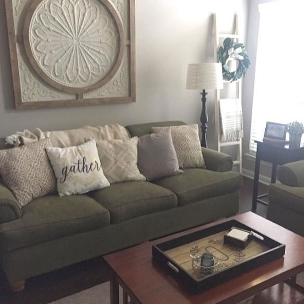 Unsure How To Fill The Wall Space Above Your Couch Decorate In One Fell Swoop By Hanging A Large Piece Of Wall Decor Living Room Couch Decor Living Room Wall