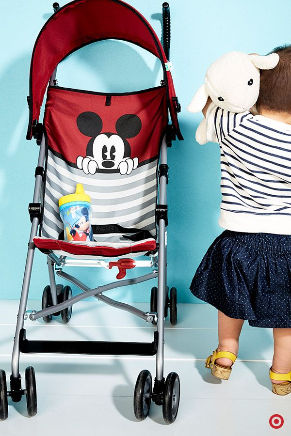 The magic of Mickey on this stroller will have your little