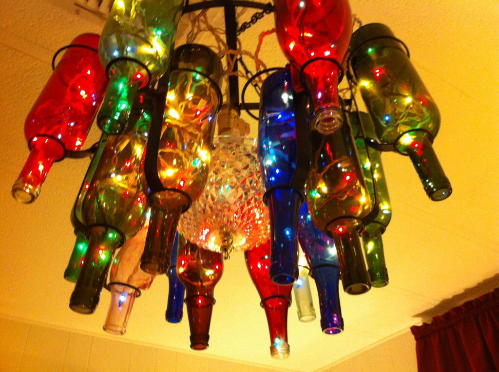 Upcycled bottle ceiling lamp with Christmas lights made by