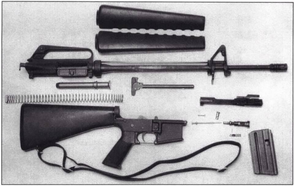 M16A1 rifle disassembled including part kits and main ...