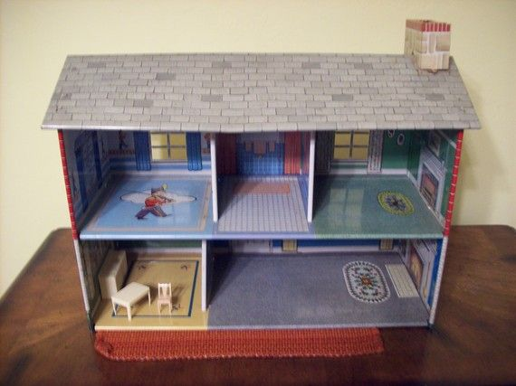 This was my doll house! Let's not forget the plastic furniture in pinks, blues, and yellows!