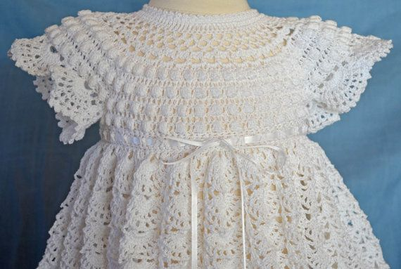 SPECIAL ORDER FOR DONNA:  This unique Christening/Blessing dress is crocheted with #10 white cotton thread & accented with white ribbon around the waist. The detail of the bodice is unlike any other Christening dress you will find, with a rounded neckline of crochet lace and a bodice adorned with rows of Popcorn stitching. The bodice is finished with short, frilly sleeves The skirt is very full with 2000 yards of thread stitched in the beautiful Crescent Fan stitch. The dress is very…