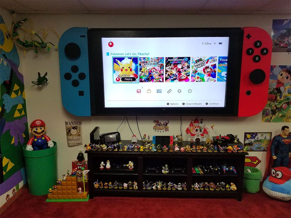 Tv made into giant Nintendo switch for game play room