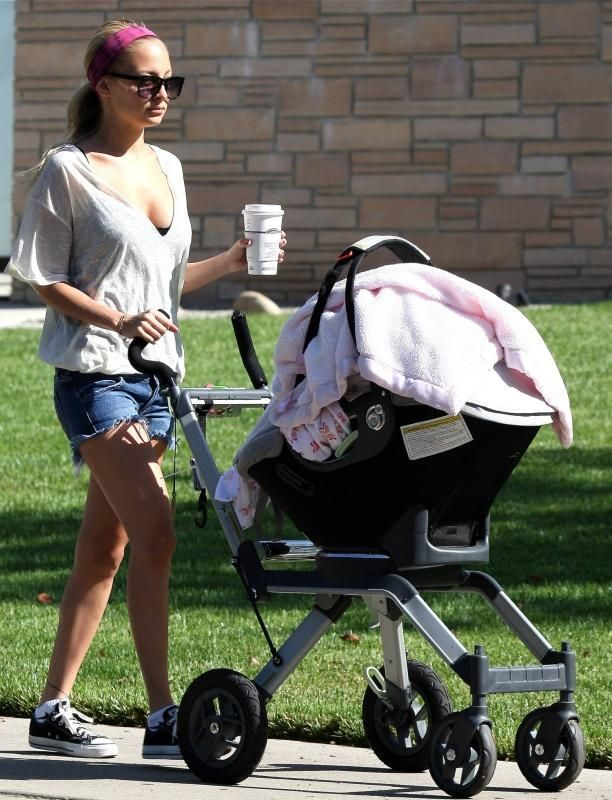 Nicole Richie wearing Converse All Star Sneakers in Black, Siwy Camilla Shorts…