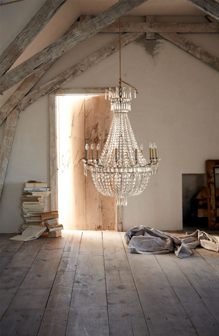 To add a little feminine chic to the living room - a simple, crystal chandelier. Light will bounce beautifully off it at night and create a lingering mood for that room.