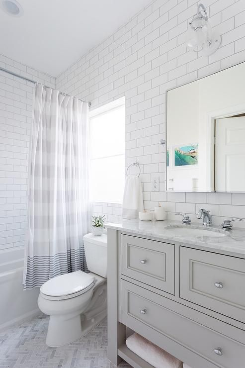 astonishing white bathroom vanity grey tile | Beautiful white and gray bathroom is fitted with a light ...