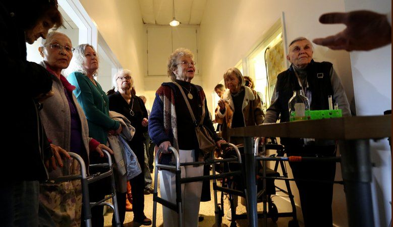 Seniors on a field trip to the Vela pot store in Sodo get a seminar in terpenes, aromatic oils that provide cannabis with various aromas and flavors. The group made it a day trip from Sound Vista Village in Gig Harbor. Barbara Krause, 84, center, enjoys the presentation.  (Alan Berner/The Seattle Times)