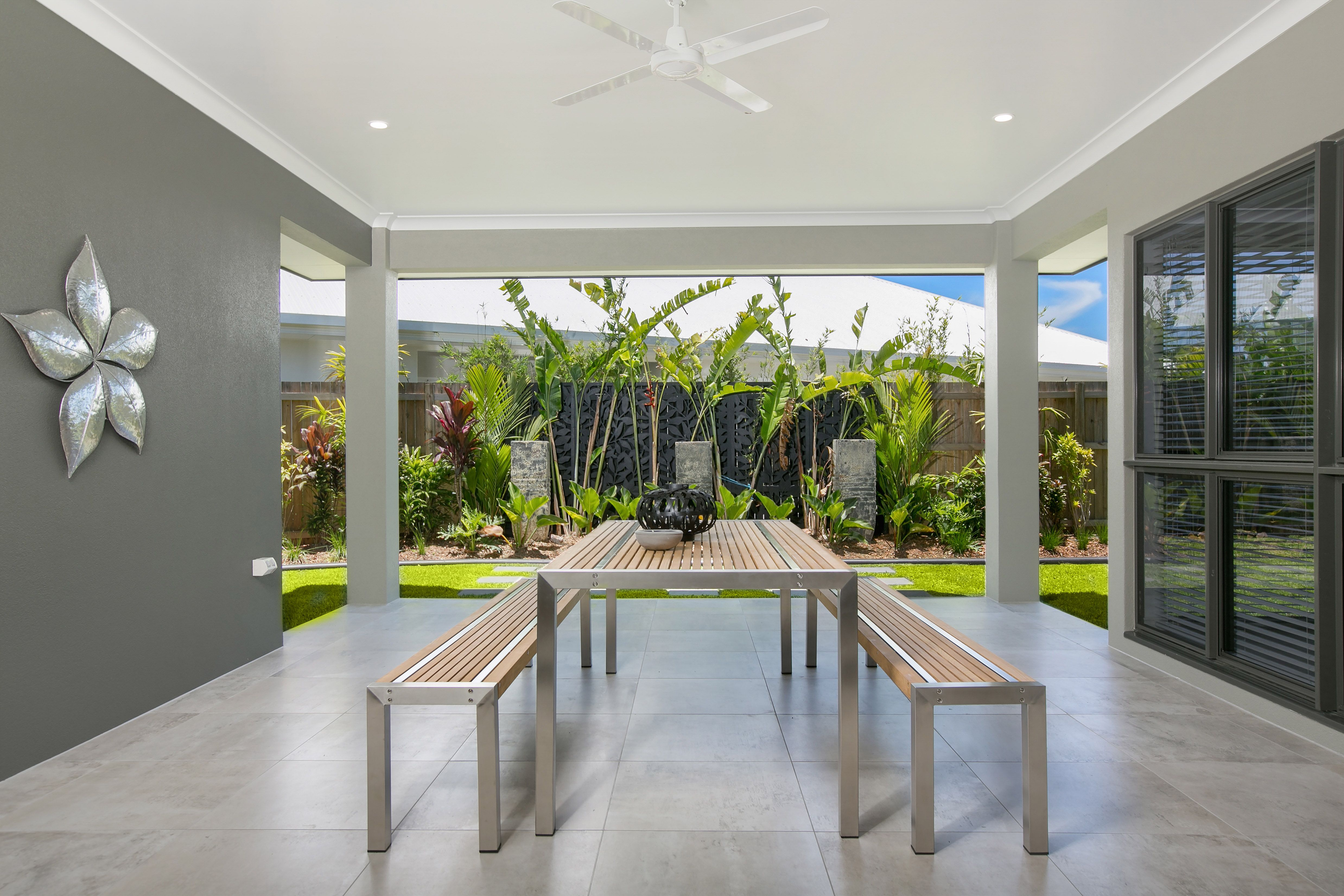 This beautiful house features a central patio area. This is a perfect place for the family to enjoy a barbecue or to entertain guests. As the patio is central, this provides easy access to the kitchen which is convenient.