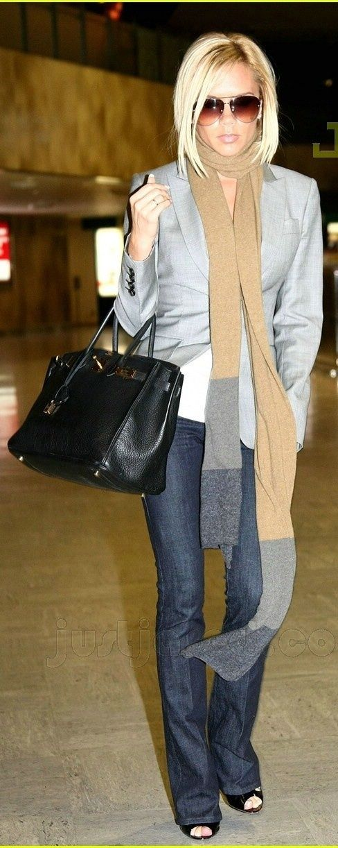 Victoria Beckham in a grey blazer with long scarf. Boot cut jeans and peep toe patten leather pumps. Black purse. Love this whole outfit!