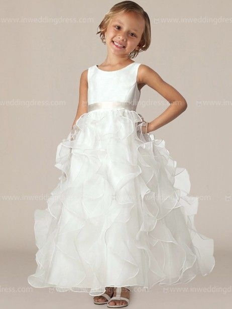 Beautiful flower girl dress accents scoop neckline, ribbon belt and ruffled skirt. Hidden back zipper.  Dress & Trim each available in 60 colors, shown in Light Ivory / Champagne.