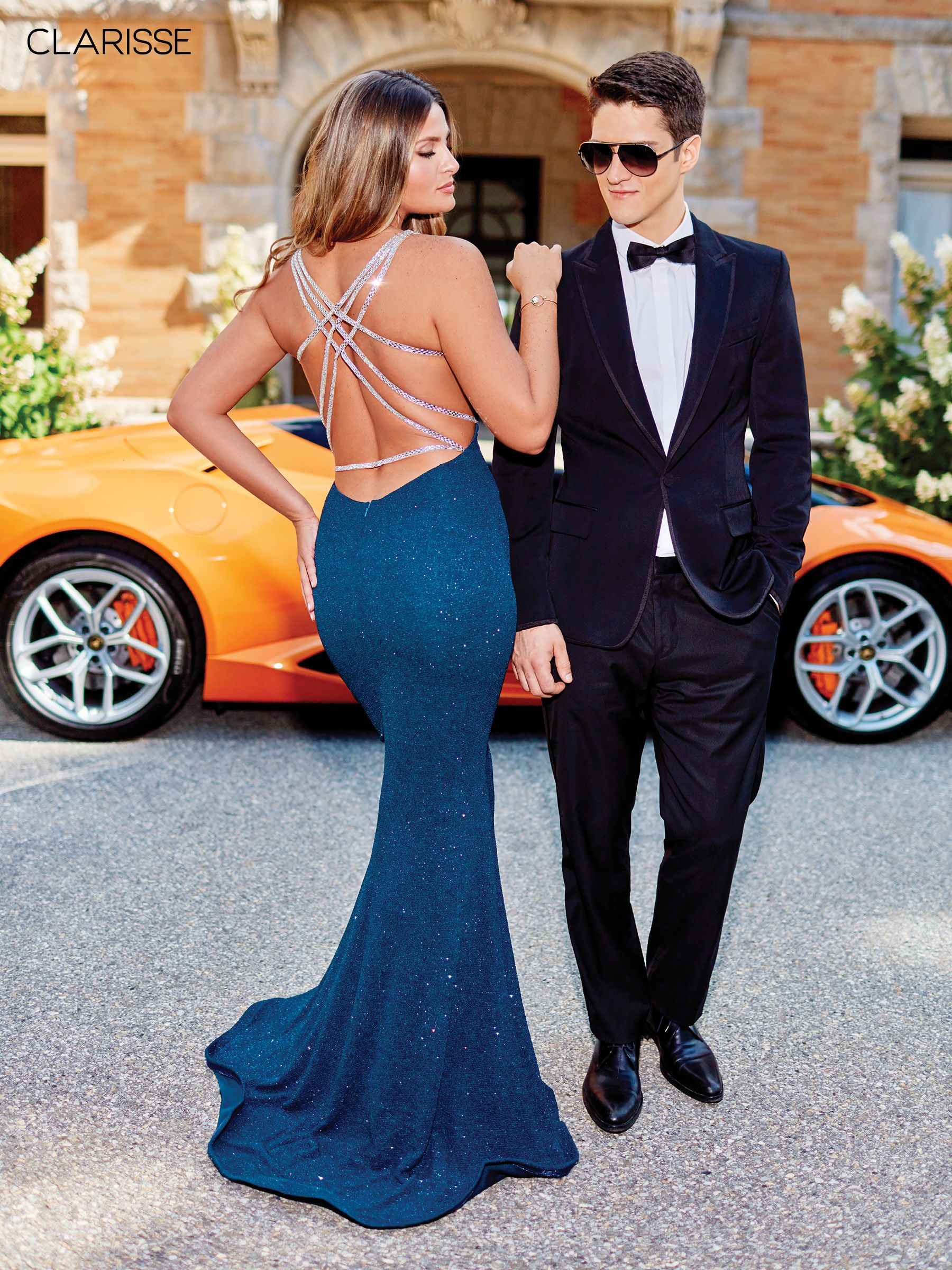 dark teal glitter jersey prom dress with cut out sides and