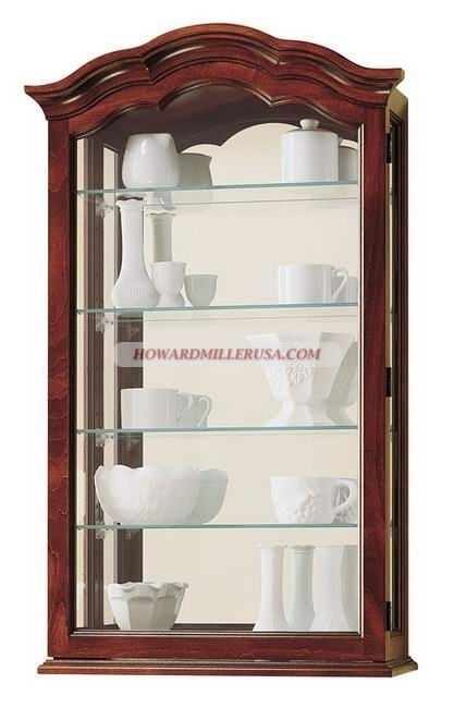Howard Miller Wall Mounting Display Cabinets Hanging Curio Cabinet In Cherry Finish And Has A Delicately Arched Pediment