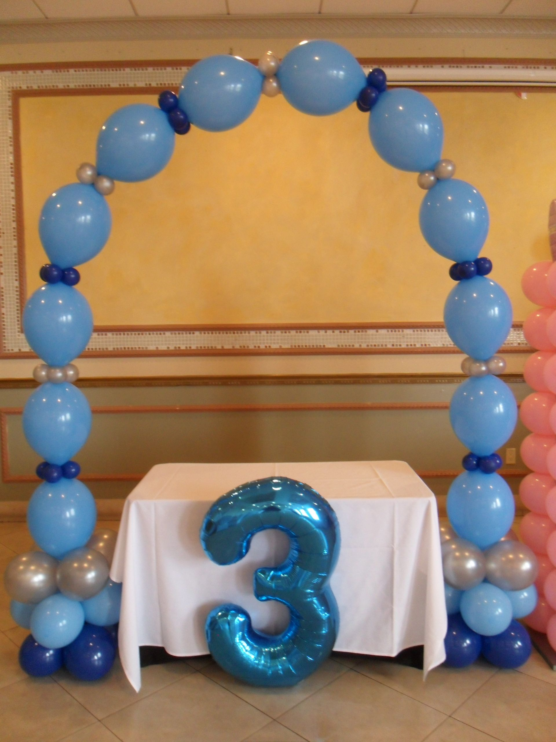 Link balloon arch USING DARK BLUE LIGHT BLUE AND SILVER balloons