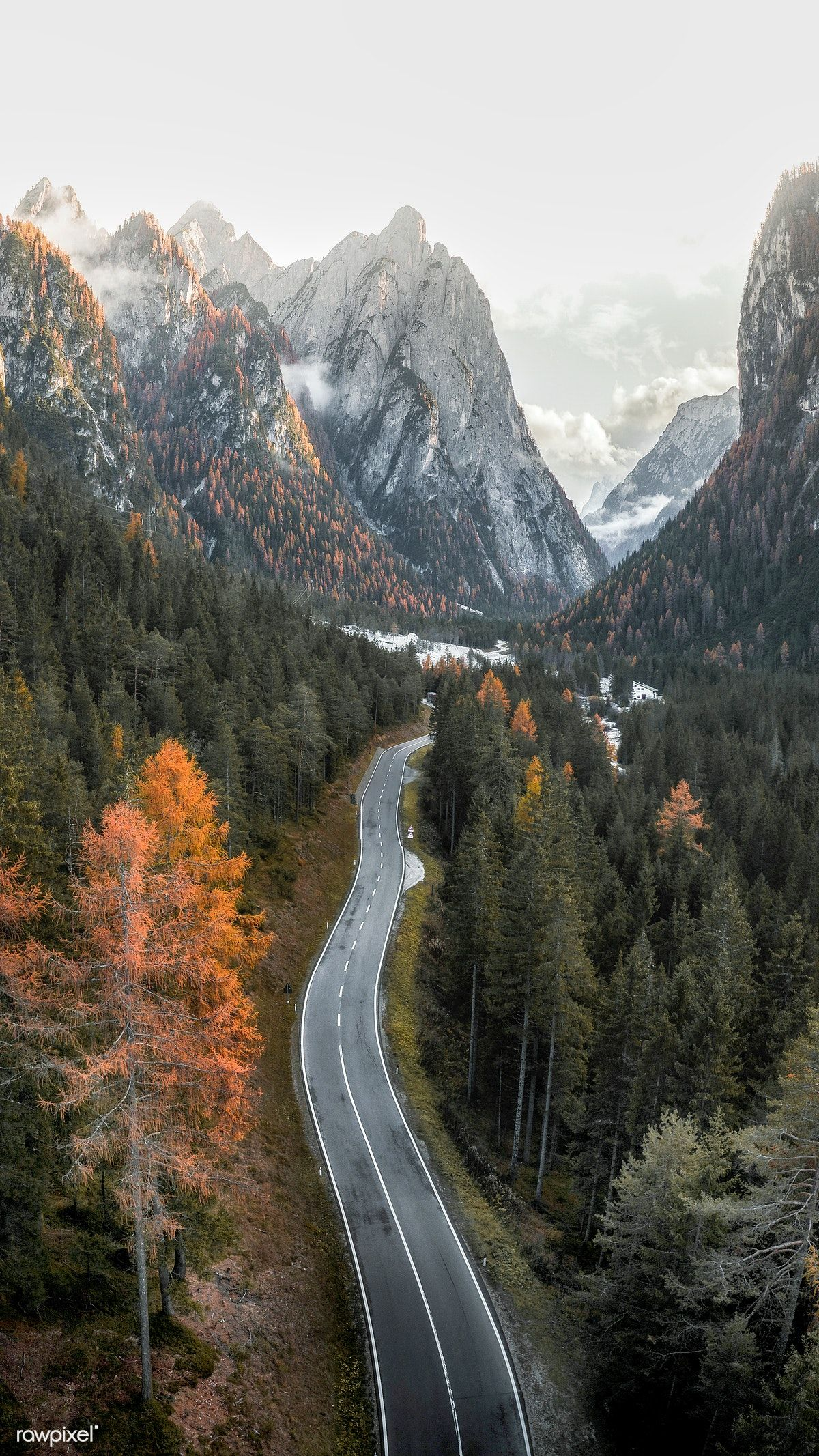 Download premium image of Drone shot of the road in Dolomites, Italy mobile phone wallpaper by Luke Stackpoole about road fall, wallpaper nature, iPhone wallpaper autumn, iphone wallpaper fall, and Wallpaper iphone hd wallpaper background 2092634