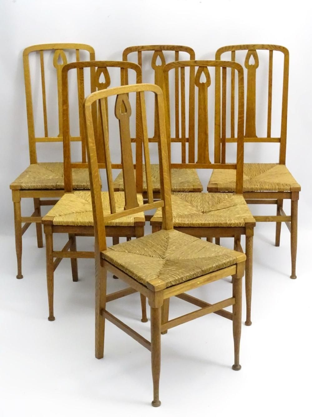 A Set Of Six Oak Arts And Crafts Dining Chairs With Pierced Back