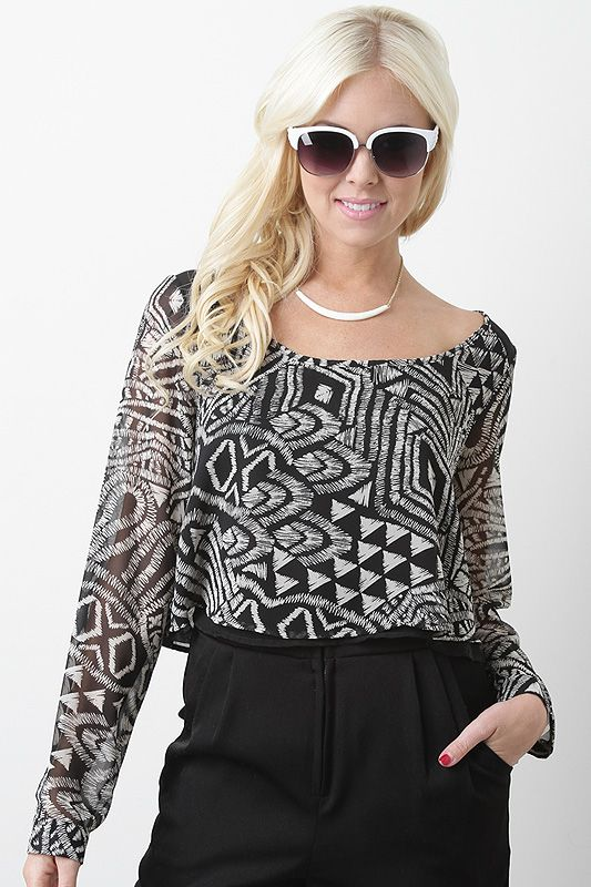 Get on top of the latest trends with the Tribal Vibe Crop Top. This crop top features semi-sheer chiffon with tribal print throughout, scoop neckline, contrasting panels at shoulders and back yoke, long cuff sleeves, crop design, and finished with cut-out at back.