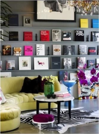 Dark Walls. Book wall store style. Color. Art. Chandelier. I like the idea!