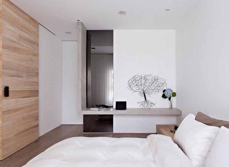 Weies Schlafzimmer mit Schiebetr und BetonAuflageflche