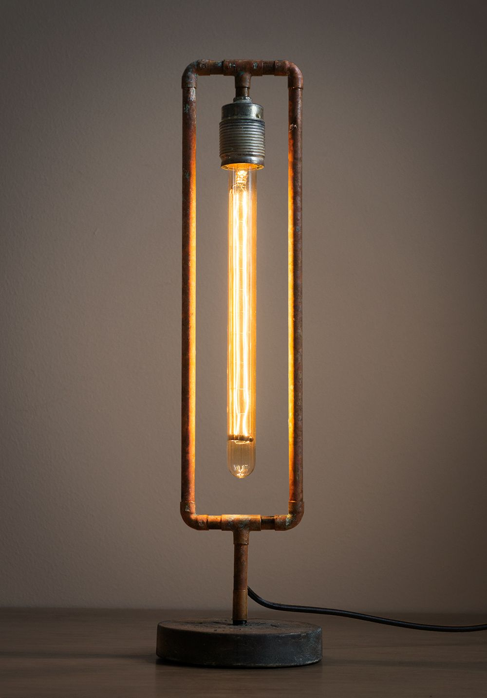 diy pipe lighting. this lamp is build from brass pipes and a 30 cm long light bulb diy pipe lighting