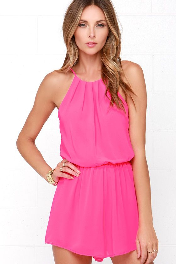 Steal a smooch from that special someone in the Borrow a Kiss Hot Pink Romper! Almost-neon pink woven poly constructs a high, halter neckline that's pleated at front and closed with a small button above a back keyhole. Wide arm openings frame a billowy, sleeveless bodice, cinched with an elastic waist. Attached shorty-shorts have a flirty, loose fit. 100% Polyester. Dry Clean Only.