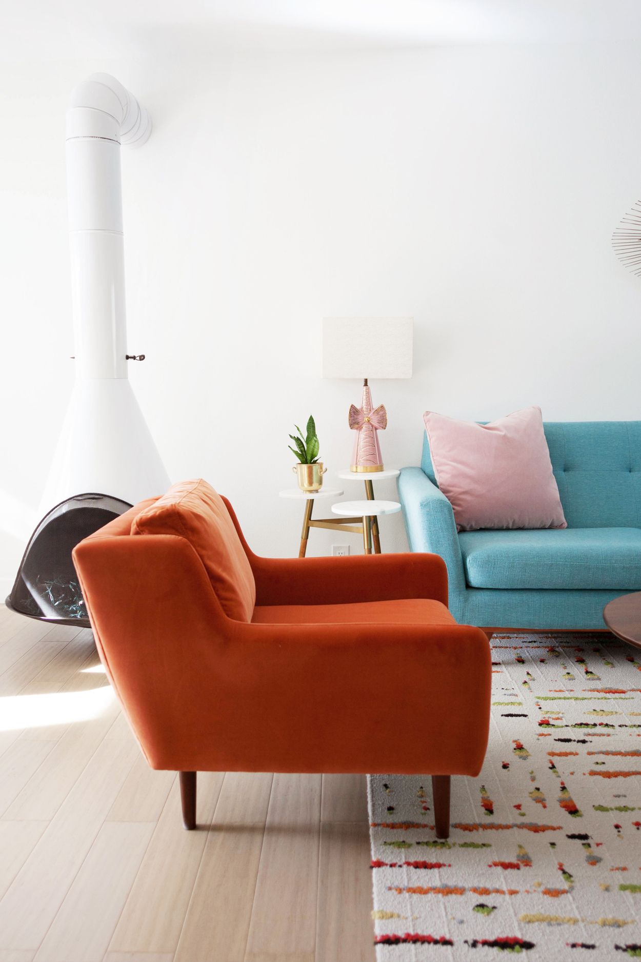 The persimmon orange matrix against my blue sofa feels very retro photo by melodrama