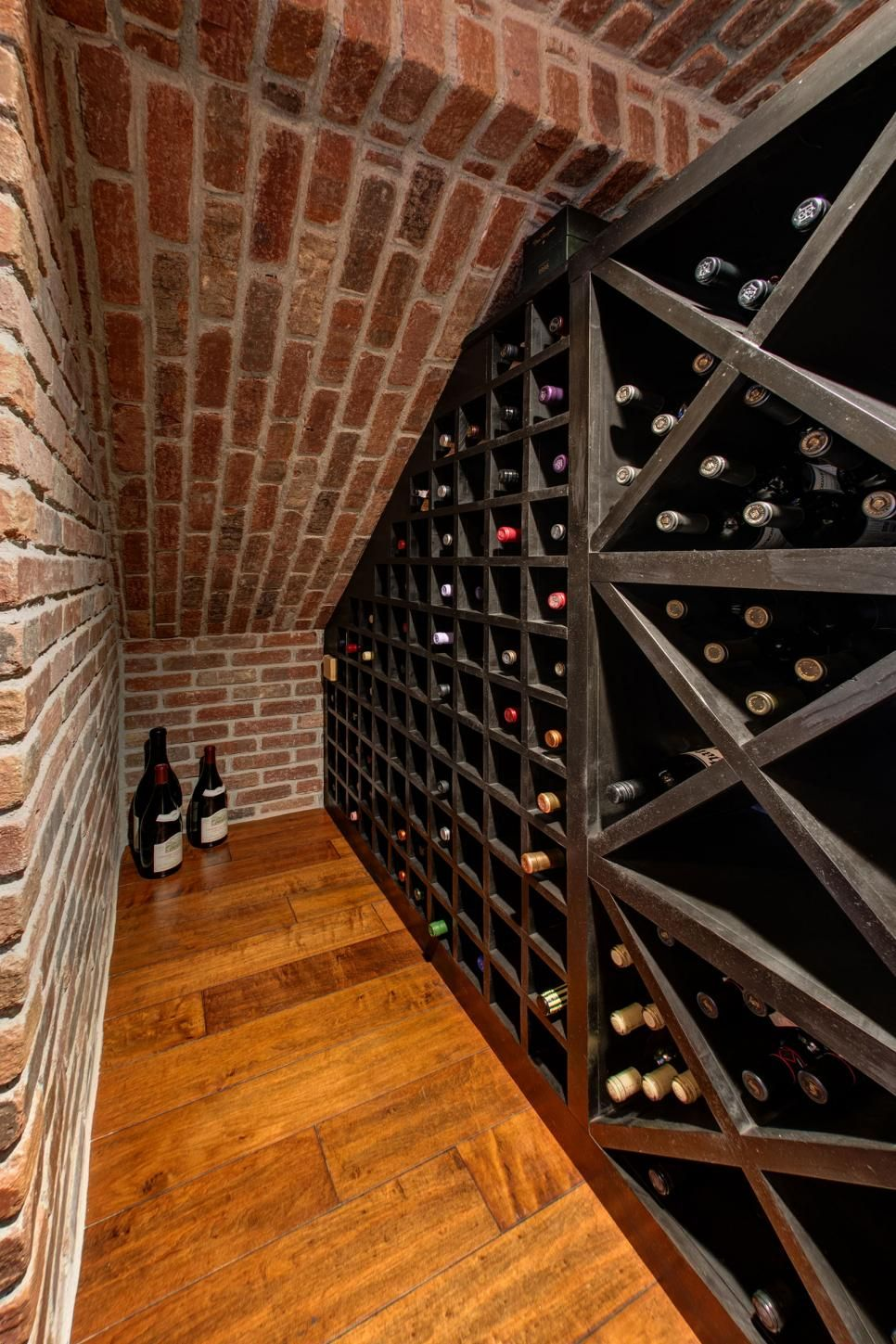 A small basement nook is put to use as a wine cellar for Wine cellar in floor