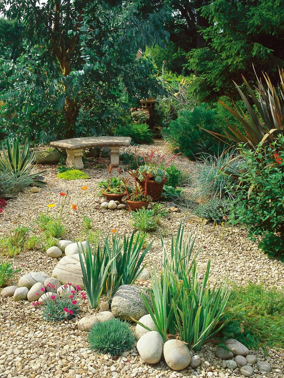 Create A Beautiful And Low Maintenance Garden Incorporating River Rock Landscaping With A Dry Str Gravel Landscaping River Rock Garden Rock Garden Landscaping
