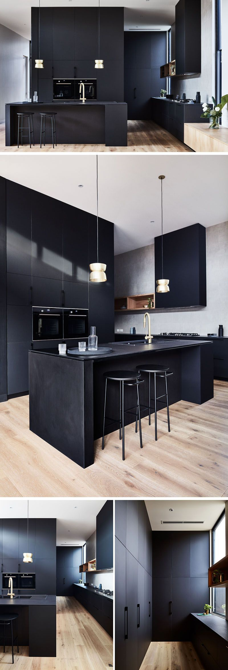 A matte black kitchen with minimal hardware makes a