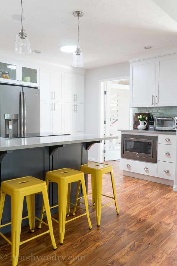 Love The Yellow Barstools And Mini Pendant Lights Above The Island!  Gorgeous White Kitchen With